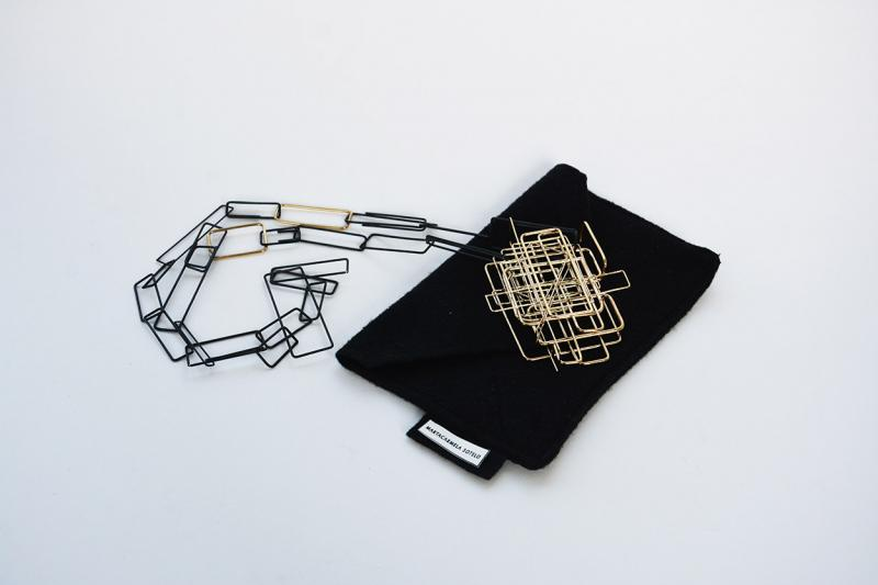 Scaffolding gold necklace and packaging